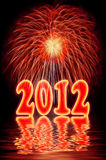 2012  new year. Fireworks (salute) with 2012  new year and reflection in water Royalty Free Stock Images
