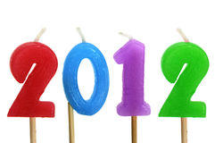 2012 new year. Number-shaped candles of different colors forming number 2012 on a white background Royalty Free Stock Photo