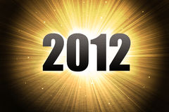 2012 new year celebration background. With gold sunburst Stock Image