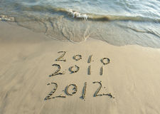 2012 new year message on the sand. Beach rn Vector Illustration