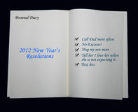 2012 New Year Resolutions. An open book/diary with 2012 resolutions Royalty Free Stock Images