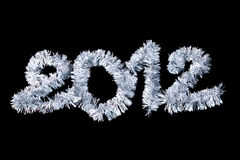 2012 New Year's made of silver tinsel. Isolated on a black background Royalty Free Stock Photos
