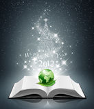 2012 new year and world on open book. 2012 happy new year and green world on open book Royalty Free Stock Images