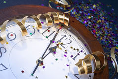2012 New Years Party Background. Clock and festive tinsels Stock Image