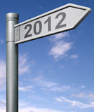 2012 next happy new year future sign. 2012 next year road sign arrow pointing towards a happy new year button icon, arrow with clipping path future Stock Photo