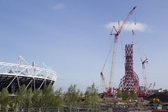 2012 Olympic Stadium. LONDON - MAY 31: A spiralling sculpture, ArcelorMittal Orbit, design by Anish Kapoor nears completion next to the 2012 Olympic Stadium in Royalty Free Stock Images