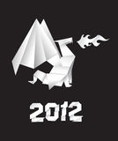 2012 Origami dragon. On the black background Royalty Free Stock Photo