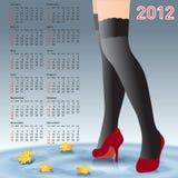 2012 pés fêmeas do calendário nas meias Imagem de Stock