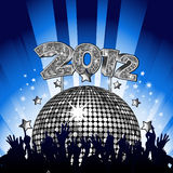 2012 Party. New year party with crowd dancing in front of silver disco ball with gold 2012 sign Stock Image