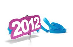 2012 party - greeting card. 2012 purple tag, white background reflection and blue streamer Royalty Free Stock Photo