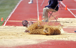 2012 Penn Relays - long jump landing Royalty Free Stock Image