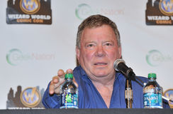 2012 Philadelphia Comic Con. PHILADELPHIA - JUNE 2: Actor William Shatner reaches for water during a Q&A during the 2012 Philadelphia Comic Con June 2, 2012 in Royalty Free Stock Images