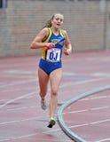 2012 pista - corredor de relais femenino del HS Foto de archivo libre de regalías