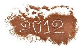 2012 scritto sulla priorità bassa del laminatoio di caffè Fotografia Stock