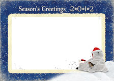 2012 Season's Greetings. Pair of polar bears with bird in snow on 2012 Christmas frame Stock Photography
