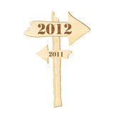 2012 sign. A signpost showing the way from 2011 to 2012. Rustic style Stock Photos