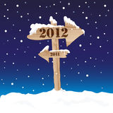 2012 sign. A wooden sign showing the way to 2012 from 2011. New Year's eve concept vector illustration