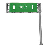2012 signboard. Highway sign pointing to 2012 straight ahead Royalty Free Stock Images