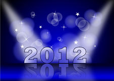 2012 Spot. 2012 on blue background and light Royalty Free Stock Image