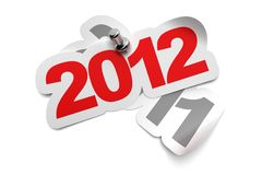 2012 sticker. Fixed onto 2011 - 3d greeting card over a white background, numbers are fixed with a metal thumbtack Stock Photography