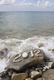 2012 on stone sea coast Royalty Free Stock Photo