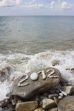 2012 on stone sea coast. Digits 2012 on stone sea coast Royalty Free Stock Photo