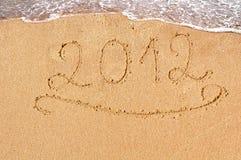 2012 text. Written on beach sand Stock Photography