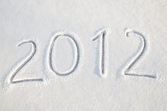 2012 text on snow. Written word 2012 on a snow field, new year concept Stock Images