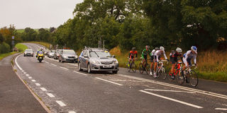 The 2012 Tour of Britain. Stage 4 of the 2012 Tour of Britain professional bicycle race.  A breakaway group lead the peloton along the A6 and through Plumpton Royalty Free Stock Photography