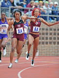 2012 Track - Female College relay runner stock images