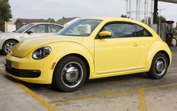 2012 Volkswagen Beetle VW Bug. 2012 yellow Volkswagen Beetle.  The new body style is a throwback to the vintage bug of the 1960s.  Bright yellow sporting factory Royalty Free Stock Photos