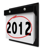 2012 - Wall Calendar Displaying New Year Date. A wall calendar with tear-away pages that read the number 2012 Stock Images