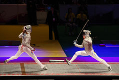 2012 World Fencing Championships in Kyiv. Yuliya Gavrilova (Russia) fights against Olena Khomrova (Ukraine) during women's sabre team final match of the World Royalty Free Stock Photo