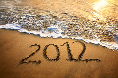 2012 year on the beach. The welcome of the new year 2012 dramatic message in the sand at the beach near the ocean Stock Image