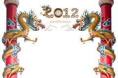 2012 Year of The Dragon. Dragon statue on pillars and word art 2012 on isolate white background Royalty Free Stock Photography
