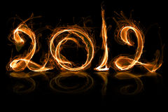 2012 year in fire. With sparkles on black Royalty Free Stock Image