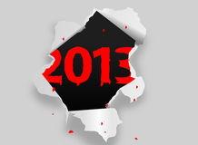 2013 background. Torn paper revealing date 2013 in red Royalty Free Stock Photos