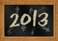 2013 on chalkboard. Illustration of 2013 with arrow on chakboard Royalty Free Stock Photography