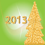 2013.Christmas tree of gold coins. 2013.Golden christmas tree green background Royalty Free Stock Images