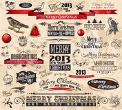2013 Christmas Vintage typograph design elements. Vintage labels. ribbons, stickers, baubles and gift boxes, birds, liquid drops, swirls and so on royalty free illustration
