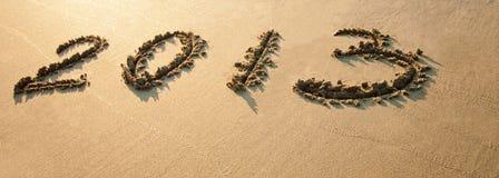 2013 desenhado na areia Fotos de Stock