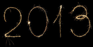 2013 digits. Digits 2013 written with sparklers isolated on black Royalty Free Stock Photography