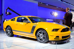 2013 Ford Mustang Boss 302. DETROIT - JANUARY 11: A reporter talking about the 2013 Ford Mustang Boss 302 at the 2012 North American International Auto Show royalty free stock images