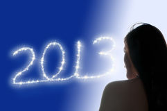 2013 Girl. Picture of a girl watching 2013 sparklers Royalty Free Stock Images