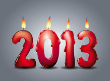 2013 lighted candles. Lighted red candles welcoming new year 2013 Royalty Free Stock Photography