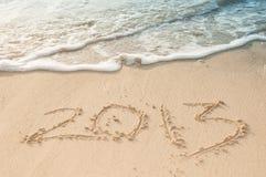 2013 merkte het zand bij het strand Stock Foto