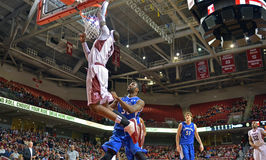 2013 NCAA Basketball - slam dunk from floor - wide angle Royalty Free Stock Photography