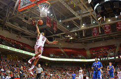 2013 NCAA Basketball - slam dunk - low angle Royalty Free Stock Photos
