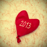 2013, new year. The number 2013, as the new year, written on a heart-shaped balloon on a marbled background royalty free stock image