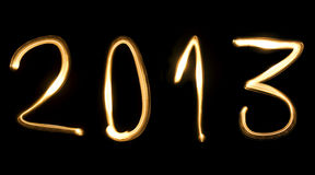 2013, the new year. Number 2013, as the new year, written with light beam on a black background Royalty Free Stock Images